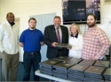 KDE Donates Laptops to Damaged Schools